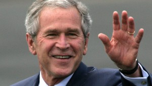 U.S. President George W. Bush waves upon arrival at RAF Aldg
