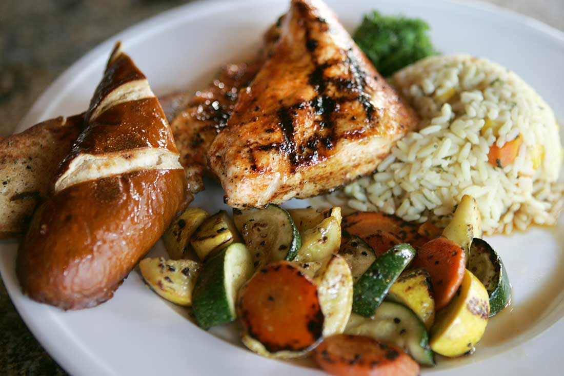 Offerings like the grilled chicken plate with house sage butter, rice pilaf, and veggies prove that there's more to Dalton's Corner than foot-high beers. Lee Chastain
