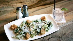 Along with a Bee's Knees signature cocktail, R Bar & Grill offers a caesar salad with fried green tomatoes. Lee Chastain