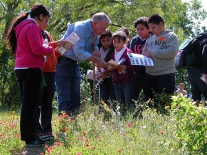 Volunteers take youngsters on prairie tours at Tandy Hills. Debora Young