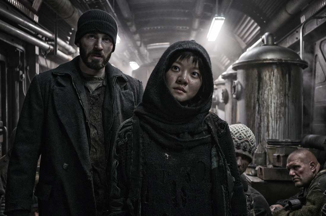 Chris Evans and Ko Ah-sung ponder how to get to the front of the train in Snowpiercer.
