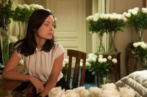 Olivia Wilde finds a lot of white roses in her hotel room in Third Person.