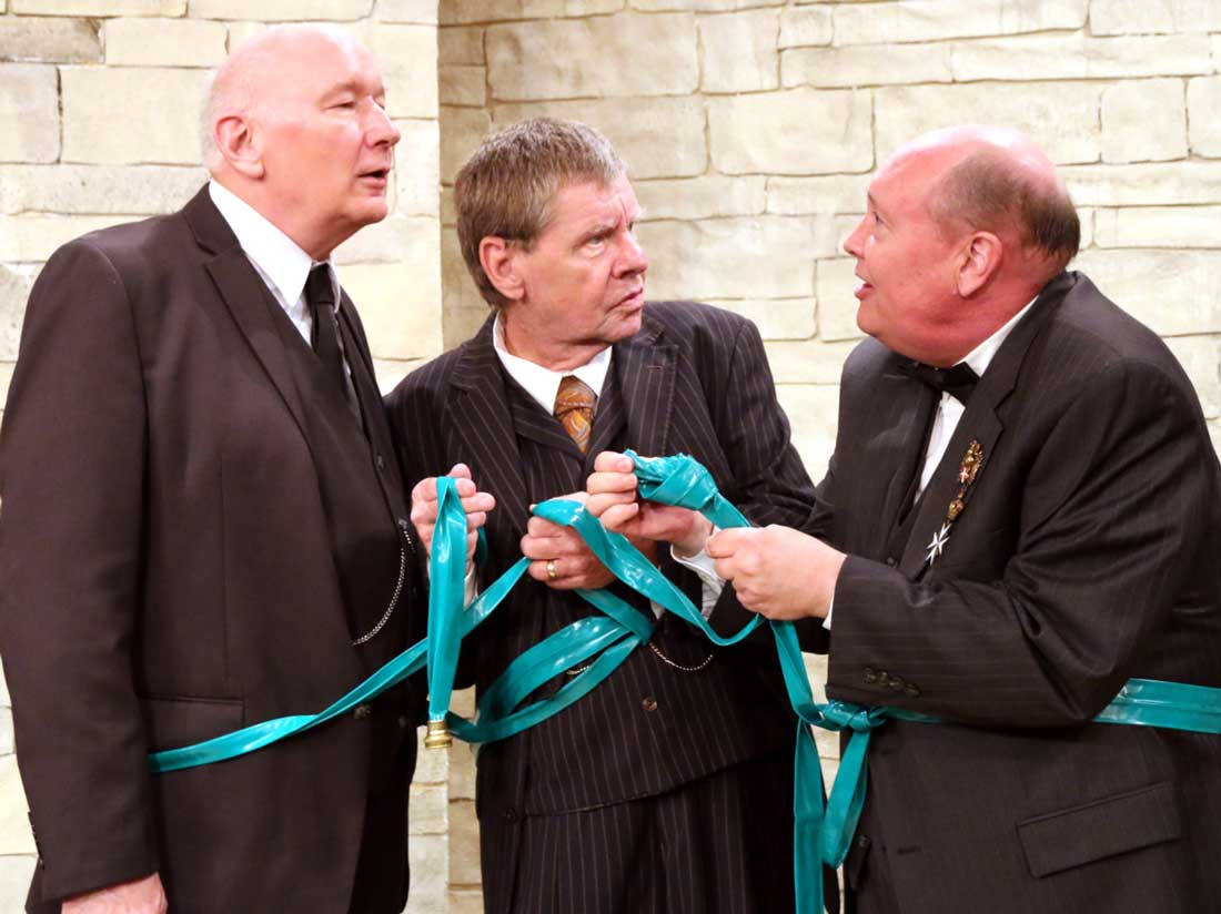 Jim Covault, Cliff Stephens, and David Coffee wind up entangled in a garden hose as part of their escape plot in Heroes. See Friday.