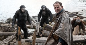 Jason Clarke (foreground) tries to make peace with our new primate overlords in Dawn of the Planet of the Apes.