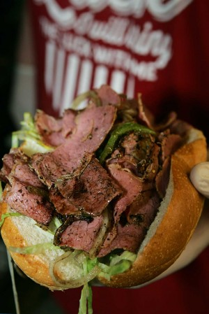 "Mo's pastrami sandwich is ""packed to bursting."" Lee Chastain"