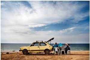 A Gazan family gathers on the beach.