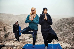 Hayat Abu R'maes and Nabila Abo teach yoga outdoors in the West Bank.