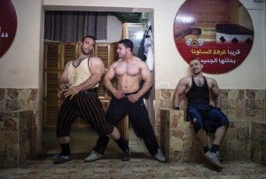 Bodybuilders in Gaza strike a pose after a workout.