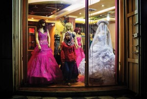 A young woman shops for a wedding dress in Gaza.
