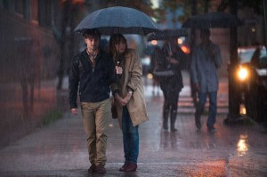 Daniel Radcliffe and Zoe Kazan share an umbrella in What If.