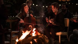 Chloë Grace Moretz and Jamie Blackley jam around a campfire in If I Stay.