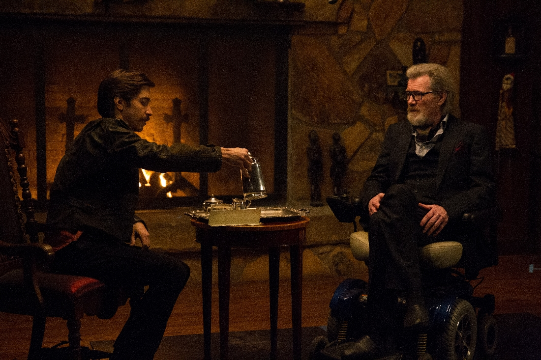 "Justin Long and Michael Parks conduct an initial interview before things get hairy in ""Tusk."""