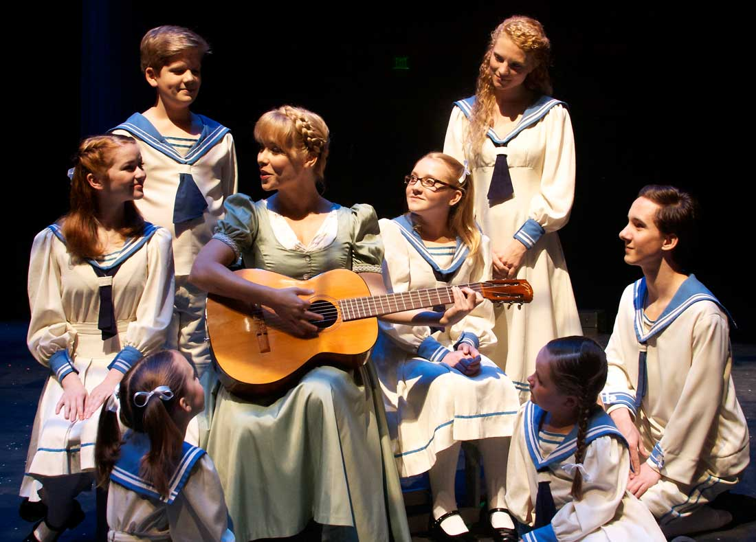 Marissa McGowan (center) teaches kids their scales in The Sound of Music.