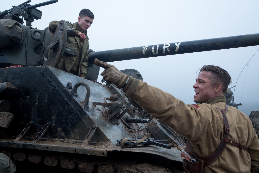 Brad Pitt (foreground) instructs Logan Lerman about operating the tank called Fury.