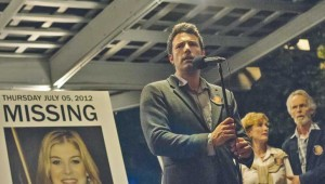 Ben Affleck stands next to Rosamund Pike's picture as he asks for the public's help in Gone Girl.
