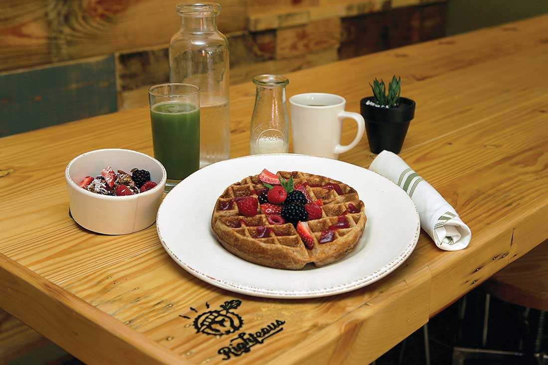 Not fancy, just fabulous: Righteous Foods' multigrain waffle with fresh fruit juice and acai bowl.