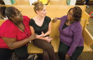 RISE participants Tina Poole, left, Crystal Jordan and Arletta Grant chat in Judge Brent Carr's coutroom.