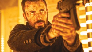 Chris Evans makes his way to the front of the train in Snowpiercer.