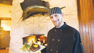 Executive chef Jordan Ray delivers a 16-oz. rib-eye finished in a 900-degree pizza oven, topped with truffle-saffron butter and accompanied by a jalapeño grit cake and grilled asparagus. Vishal Malhotra