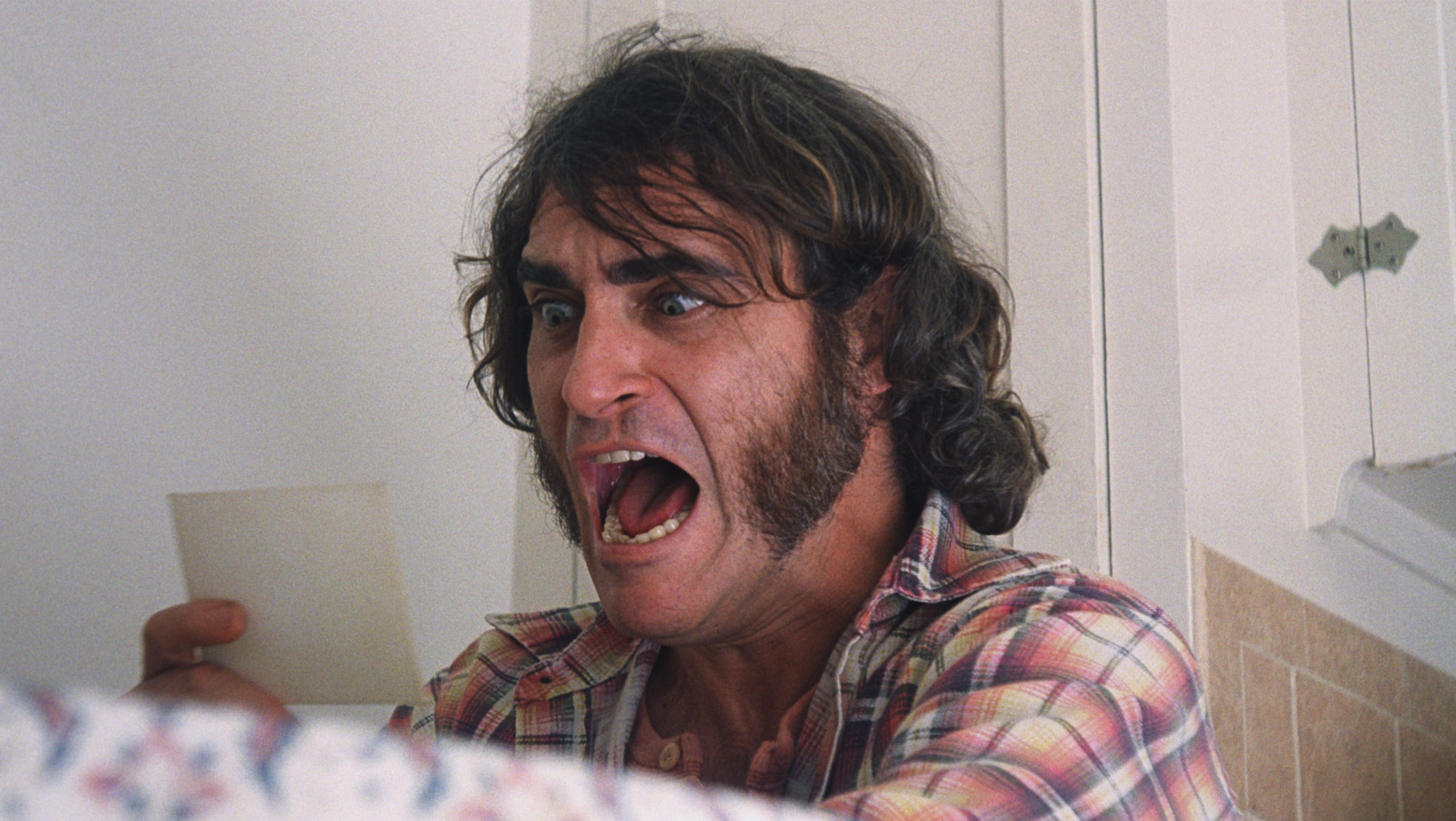 "Joaquin Phoenix is flabbergasted by the complexity of his newest case in ""Inherent Vice."""