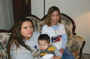 Meza (left) with her 1-year-old son and Jessica Castillo