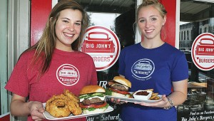 Alexandra Hall (left) and Dusti Day must get quite a biceps workout hauling around Big John's burgers. Lee Chastain