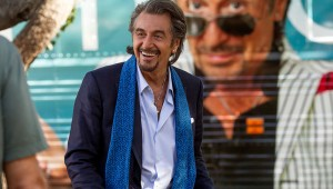 Al Pacino cracks a smile in front of his tour bus in Danny Collins.