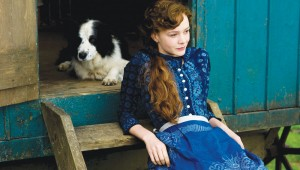 With a faithful border collie, Carey Mulligan surveys her holdings in Far From the Madding Crowd.
