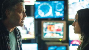 In front of monitors forecasting doom, George Clooney and Britt Robertson have it out in Tomorrowland.