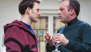 Justin Lemieux and Jakie Cabe have an ecclesiastical disagreement in Circle Theatre's Mass Appeal.
