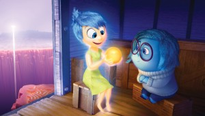 Aboard a train of thought, Joy and Sadness regard one of Riley's happy memories in Inside Out.