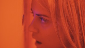 "Taylor Schilling sees her new friends up to some weird sexual practices in ""The Overnight."""