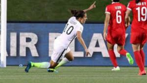Carli Lloyd wheels away after scoring the winning goal for USA against China.