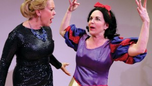 Wendy Welch (dressed as the Wicked Queen) and Shannon J. McGrann (dressed as Snow White) bicker on their way to a costume party in Vanya and Sonia and Masha and Spike.