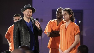 JEFF ROSS INTERVIEWING ONE OF THE LESS DANGEROUS LOOKING CONVICTS (courtesy Comedy Central).