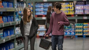 "Cara Delevingne and Nat Wolff share a meaningful moment in a big-box retail store in ""Paper Towns."""