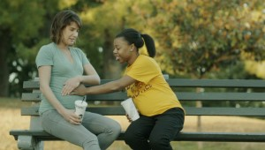 Cobie Smulders lets Gail Bean feel her pregnant stomach in Unexpected.