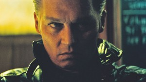 Johnny Depp ponders his next criminal misdeed in Black Mass.