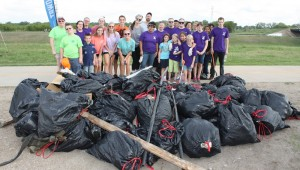 VOLUNTEEERS AT LAST YEAR'S TRINITY RIVER TRASH  BASH SHOW OFF THEIR HAUL. (photo courtesy of Trinity River Vision Authority)