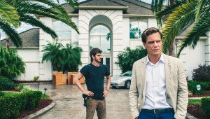 Andrew Garfield and Michael Shannon eyeball a potential new property in 99 Homes.
