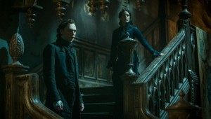 "Tom Hiddleston and Jessica Chastain preside over a dark realm in ""Crimson Peak."""