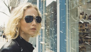 Joy to the world! Jennifer Lawrence celebrates the holiday under fake snow.