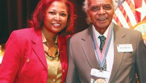 Genma Holmes poses with Congressional Gold Medal recipient Mark McCann Sr., one of the first black Marines. Holmes profiled McCann in the magazine she produced. Courtesy of Genma Holmes.