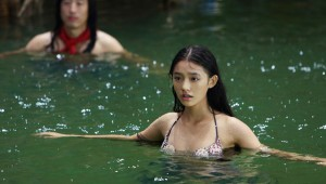 "Lin Yun receives her, uh, swimming orders in ""The Mermaid."""