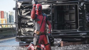 Ryan Reynolds strikes a pose after killing a bunch of bad guys in Deadpool.
