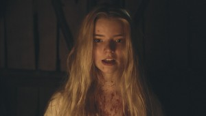 A blood-spattered Anya Taylor-Joy looks to Hell for guidance in The Witch.