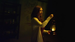 "Brigid Brannagh searches the darkness outside her Moldovan house in ""They're Watching."""