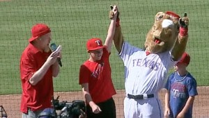 Rush Olsen and Rangers Captain have fun with the crowd before games at the ballpark.