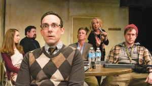 Curtis Raymond Shideler (foreground left) tries to placate a restive cast in Circle Theatre's Don't Talk to the Actors.