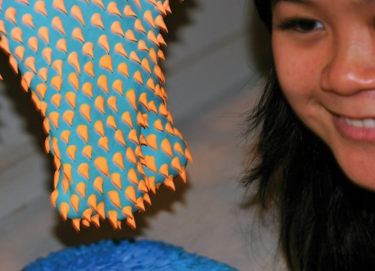 Dan Lam uses a cake frosting squirter to apply the tiny horns to her sculptures. Photo by Jeff Prince.